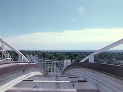 Point of view of first lift and first drop of a wooden roller coaster. Stock Footage