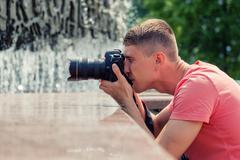 Professional male photographer Kuvituskuvat