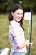 Portrait of teenage girl practicing archery Stock Photos