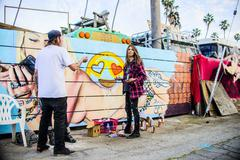 Graffiti artists by painted wall, Venice Beach, California, USA Stock Photos