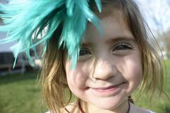 Girl with feather fascinator - stock photo