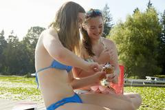 Girls in bikini enjoying lake, Seattle, Washington, USA - stock photo