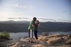 Couple having fun on hill, Angel's Rest, Columbia River Gorge, Oregon, USA - stock photo