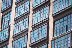 Detail of apartment windows of old industrial building, Manhattan, New York, USA Stock Photos