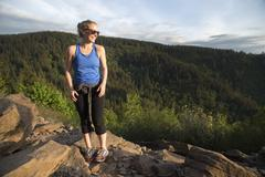 Woman enjoying view on hill, Angel's Rest, Columbia River Gorge, Oregon, USA - stock photo