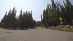 Motorhome driving through alpine forest on Mount Evans-POV point of view. Stock Footage