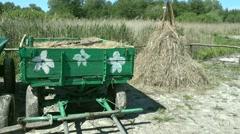 Hay wagon and a haystack Stock Footage