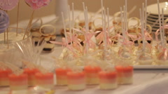 Wedding table with sweets and cakes, pastries sweets Stock Footage