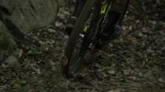 Extreme Mountain Biking - slow motion riding through pile of leaves Stock Footage