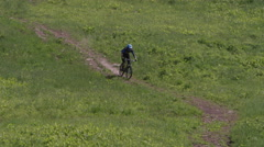 Extreme Mountain Biking - Bombing down a hill on a bicycle - stock footage