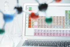 Lap top with periodic table and ball and stick molecular model Kuvituskuvat