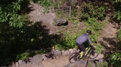 Extreme Mountain Biking - Riding thick trail Stock Footage