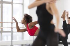 Young women in dance studio dancing, differential focus - stock photo
