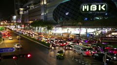 MBK centre Bangkok night traffic view Stock Footage
