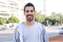 Portrait of young latin man. Urban scene. Stock Photos
