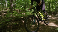 Extreme Mountain Biking on forested trail Stock Footage