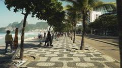 walking along ipanema side walk in rio de janeiro, brazil - stock footage
