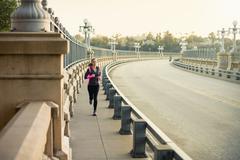 Jogger running on bridge, Arroyo Seco Park, Pasadena, California, USA Stock Photos