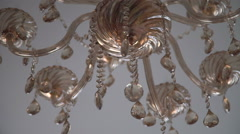 Crystal chandelier moving. Big classic crystal background - stock footage