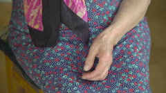 Old grandmother's hands shelling green peas in the village Stock Footage