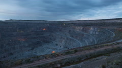 Time lapse. Iron ore quarry at dawn. Sky. Moving clouds Stock Footage
