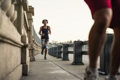 Joggers running on bridge, Arroyo Seco Park, Pasadena, California, USA Stock Photos