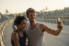 Joggers taking selfie on bridge, Arroyo Seco Park, Pasadena, California, USA Stock Photos