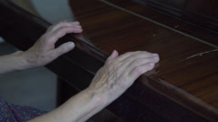 Grandmother opens the piano and starts to play - stock footage