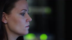 View of woman using stylus on monitor of network server Stock Footage