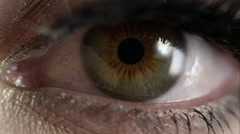 Up close view of woman's hazel eye - stock footage