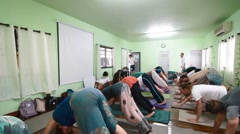 Yoga class doing downward dog Stock Footage