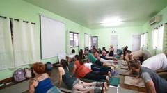 Yoga class doing cobra pose Stock Footage