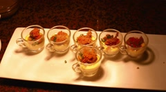 closeup cups of custard caviar - stock footage
