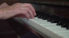 Old wrinkled woman's hands playing the piano. Close up Stock Footage