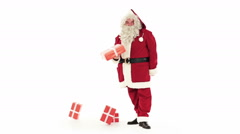 Santa Claus drop gifts that is delivering isolated on white Stock Footage