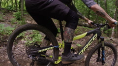 Extreme Mountain Biking in the summer on a trail Stock Footage