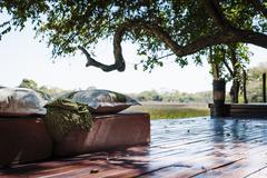 View of seats at safari lodge, Kafue National Park, Zambia Stock Photos