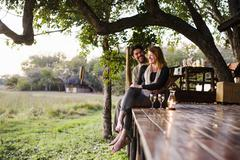 Couple relaxing at safari lodge, Kafue National Park, Zambia Kuvituskuvat