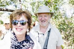 Portrait of senior man and wife on safari in Zambia Stock Photos