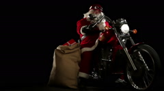 Santa Claus portrait on his red motorbike slow motion Stock Footage