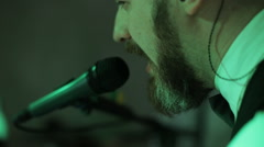 Close-up of singer touching microphone singing Stock Footage