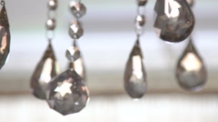 Luxury crystals of a classic chandelier on a light background. Slow motion Stock Footage