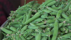 Hands pod shell hull husk green peas. Slow motion - stock footage