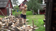 Farmer chop log with axe and drink cold water after work. 4K Stock Footage