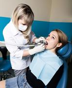 The reception was at the female dentist. Doctor examines the oral cavity on Stock Photos