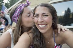 Self portrait of two young women celebrating Independence Day, USA - stock photo