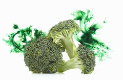 Broccoli stems with corresponding coloured digital burst effect Stock Photos