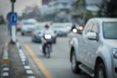 Car and motorcycle driving on road with traffic jam in the city, abstract blu Stock Photos