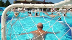 People water polo play in the pool, conceptual of a summer vacation and travel Stock Footage