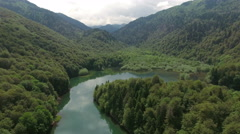 Aerial shot of second part of Biograd lake in deep lush of woods. Montenegro Stock Footage
